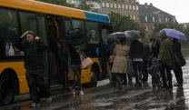 Flooding in Copenhagen 31st of August 2014 – rainy people at bus stop